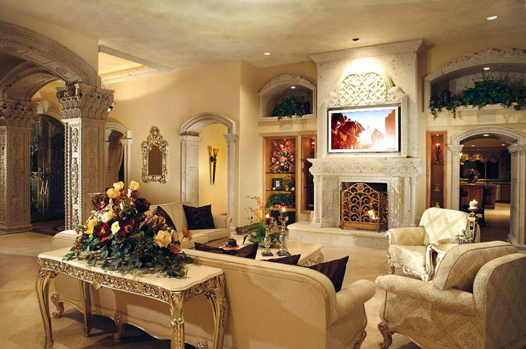 This exquisite fireplace masterpiece is hand carved in natural cantera stone. To the left you will see the stunning columns with fine intricate details carved in cantera stone.