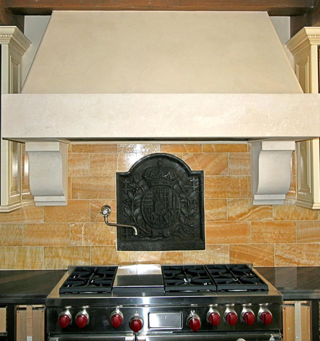 This simple and elegant range hood in limestone is wonderfully hand carved and exquisitely finished to accentuate your home.